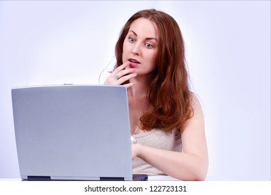 Pretty girl shocked look on laptop