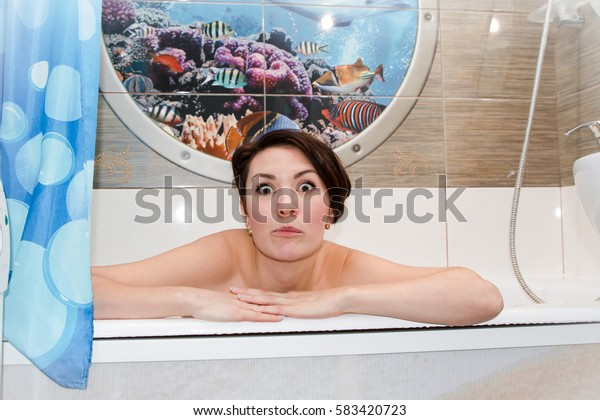 Pretty girl with short hair in a beautiful bathroom