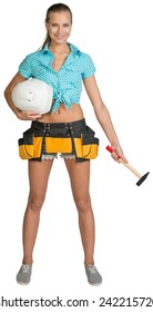 Pretty girl in shorts, shirt and tool belt holding white hard hat and hammer. Full length. Isolated over white background