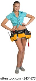 Pretty girl in shorts, shirt and tool belt with tools standing with hands on hip. Full length. Isolated over white background