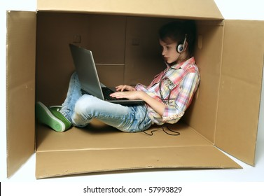 Pretty girl sitting at the box and using laptop.