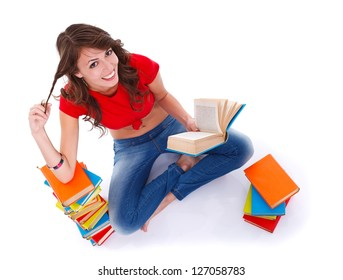 Pretty girl sitting in the floor and reading