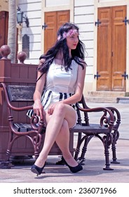 Pretty girl sitting on the bench