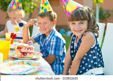 Pretty girl smiling at child's birthday party