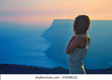 Pretty girl stay on the top of the mountain and see to the horizon with beautiful background. Colorful photo of the natural sunset over the sea.  vertex, cove, miracle, unbelievable, scenery,