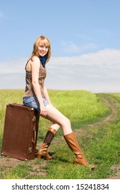 pretty girl with a suitcase outdoor