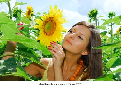 Pretty girl in sunflowers