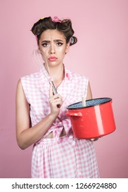 pretty girl in vintage style. pinup girl with fashion hair. perfect housewife. pin up woman with trendy makeup. retro woman cooking in kitchen. Tired of cooking.