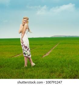 a pretty girl walking on the field