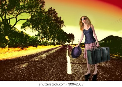 pretty girl walking on the road with her baggage
