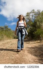 Pretty girl walking on a track