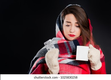 Pretty girl in warm winter clothes, isolated, on black background