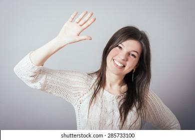 pretty girl waving