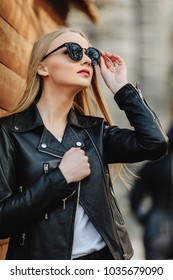 Pretty girl wear sunglasses and drink coffee on the street