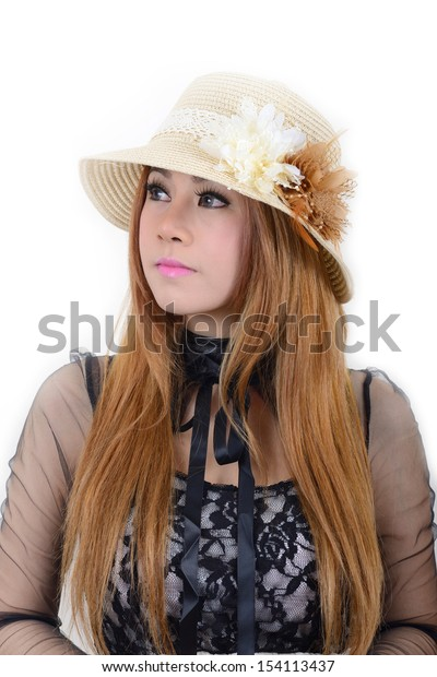 Pretty girl wearing a beautiful weave hat on white background.