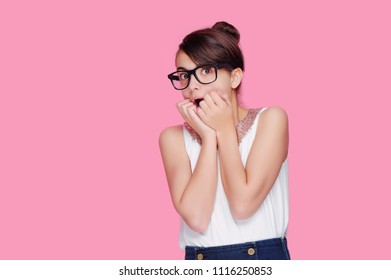 Pretty girl wearing glases expressing amazement isolated on pink background