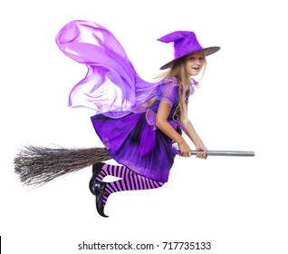 Pretty girl wearing witch halloween dress flying on a broom