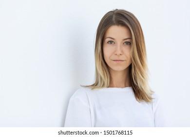 Pretty girl in white shirt on white background