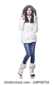 pretty girl in winter clothes posing on white background