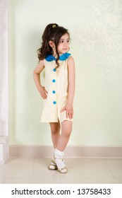 pretty girl in yellow dress with blue buttons