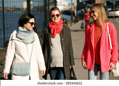 Pretty girls walking on the city streets and smiling