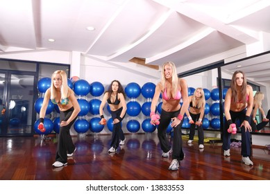 pretty girls working out in a fitness club
