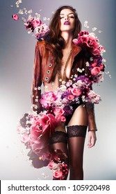 pretty gorgeous erotic woman in brown jacket with flowers