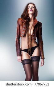 pretty gorgeous erotic woman in brown jacket