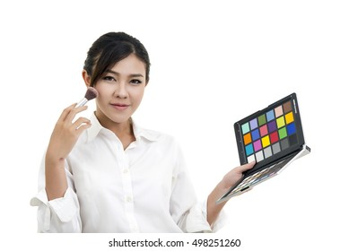 Pretty happy business  woman doing makeup isolate white background