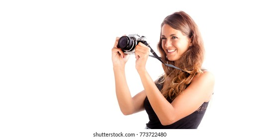 Pretty happy girl holding a vintage camera; isolated on white, customizable background with copy space