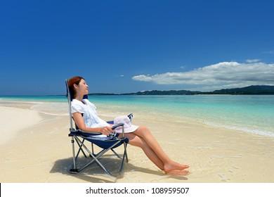 A pretty happy young woman enjoying at a beach