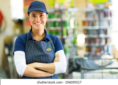 pretty hardware store employee looking at the camera