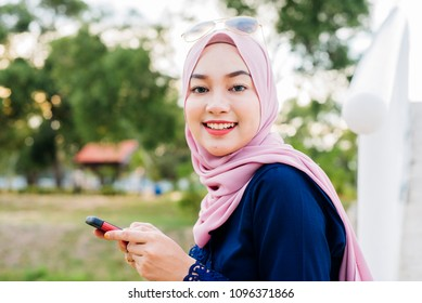 pretty hijab women use a cellphone