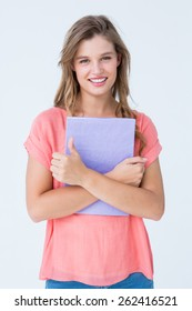 Pretty hipster holding notepad on white background