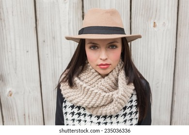Pretty hipster looking at camera against bleached wooden planks