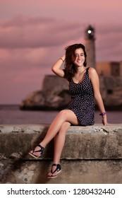 Pretty hispanic teenage girl in Havana at sunset