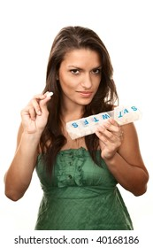 Pretty Hispanic Woman with Daily Nutritional Supplements