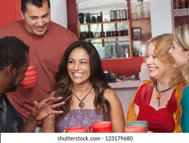 Pretty Hispanic woman and diverse group of friends