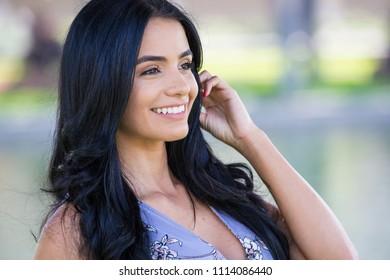 Pretty hispanic woman outside