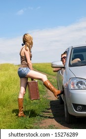 pretty hitchhiker persuades a man to give her a lift
