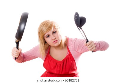 pretty housewife with kitchen utensil and pan isolated on white background
