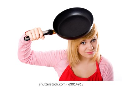 pretty housewife with pan on her head isolated on white background