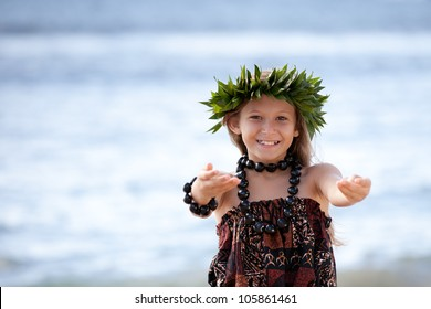 Pretty Hula Girl dancing at the beach wearing a handmade head piece