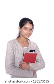 Pretty Indian/ Asian college student over isolated white background.