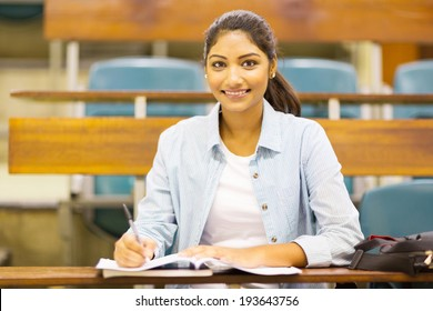 pretty indian female university student in lecture hall
