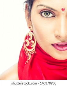 Pretty Indian girl with red designer skirt posing to the camera