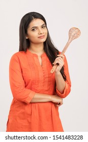 Pretty Indian woman holding wooden skimmer