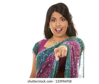 pretty indian woman pointing on white isolated background