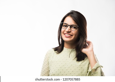 Pretty Indian young girl wearing clear eye Glasses or Spectacles with a smile, standing isolated over white background