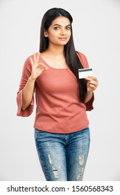 Pretty Indian young woman with credit card.